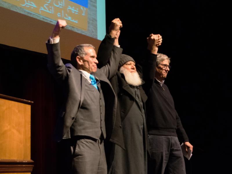 Bloomington Mayor Tari Renner joining hands with Bloomington's Imam Abu-Emad Al-Talla and Mayor Chris Koos of Normal at a community solidarity rally sponsored by Not In Our Town in February.