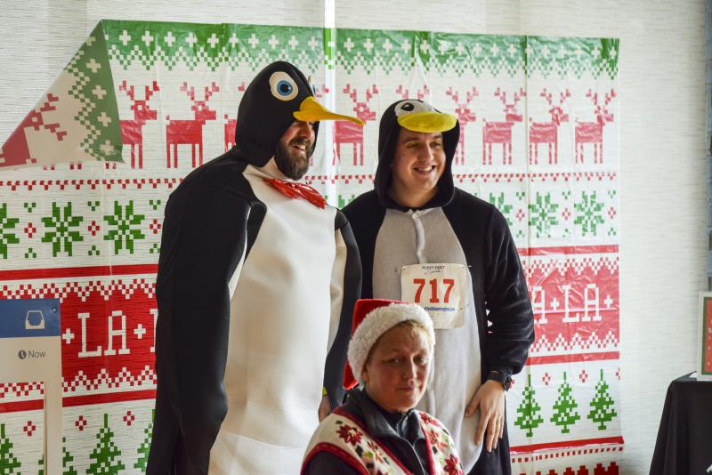 Instead of sweaters, these two dressed as penguins to show off their festive spirit at the Ugliest Sweater Run.