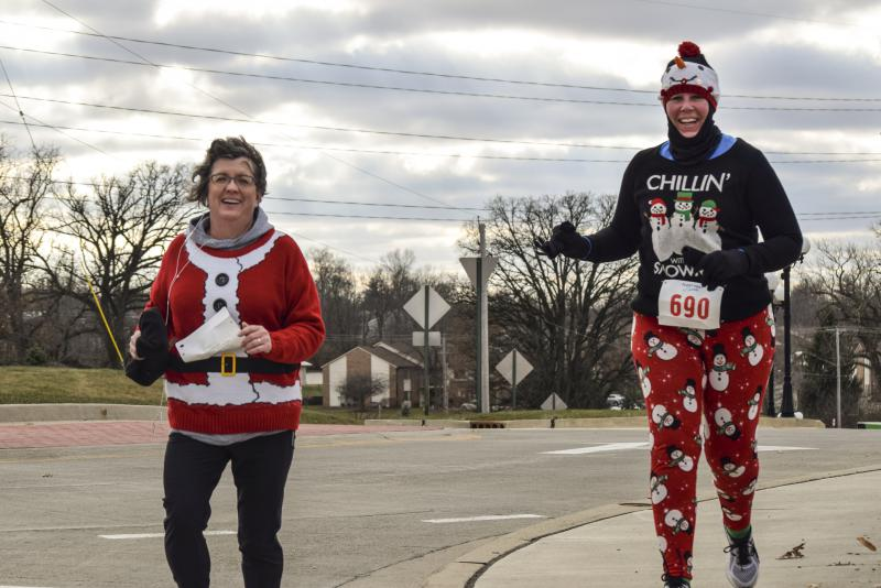 These two runners kept warm in their festive gear at the Ugliest Sweater Run.