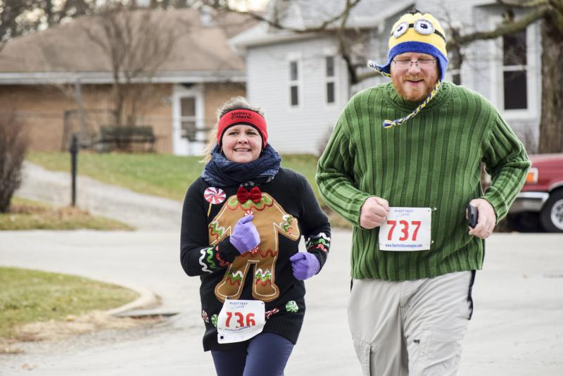 These two wore festive hats and sweaters to keep warm at the Ugliest Sweater Run.