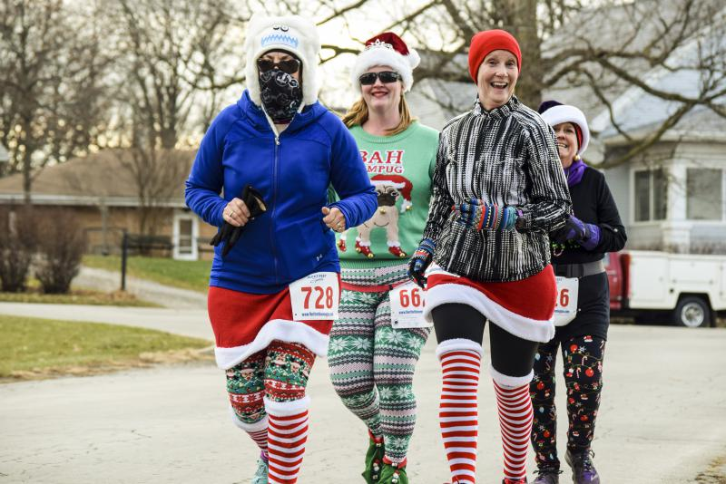 These participants wore holiday patterns along with fesitve sweaters at the Ugliest Sweater Run.