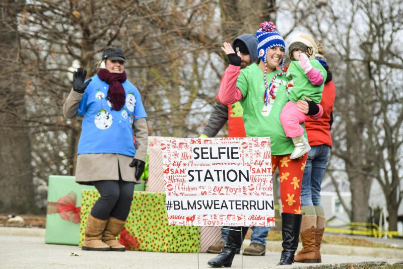 Volunteers helped runners take selfies.