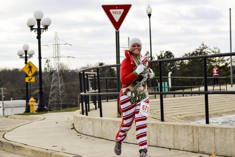This participant sported a Grumpy Cat onezie while running the Ugliest Sweater Run.