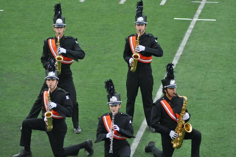 The Normal Community High School marching band performs during a competition.