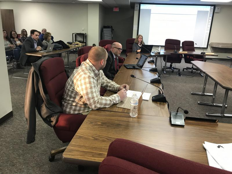 McLean County Board member Ryan Scritchlow, left, and Ecology Action Center Director Michael Brown, center, present during a Land Use Committee meeting on a proposed 20-year solid waste management plan.