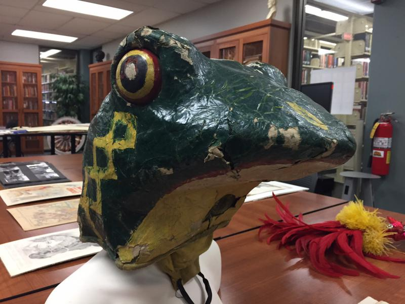 This frog head was once part of a contortionist's costume. It's part of the collection donated to MIlner Library.