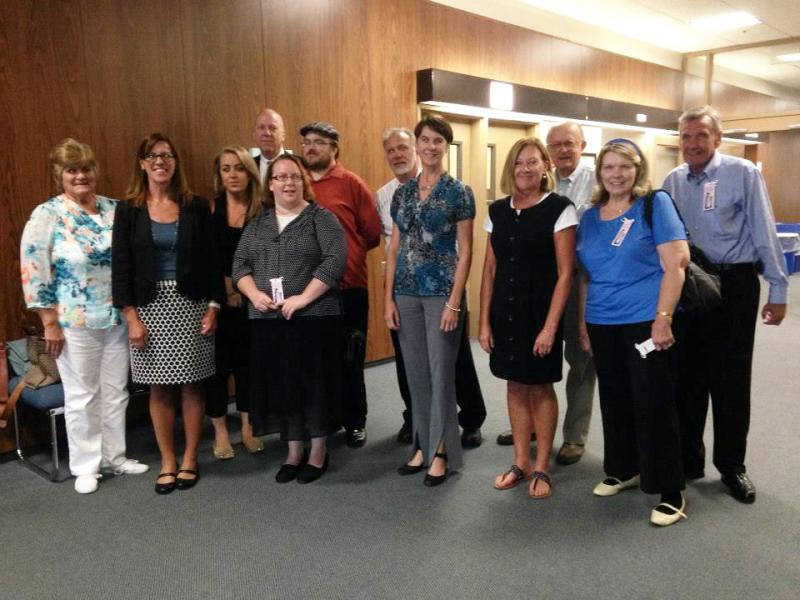Illinois Innocent Project lawyers and students and Barton McNeil's family members at a DNA hearing in August 2014 at the McLean County Law and Justice Center in Bloomington.