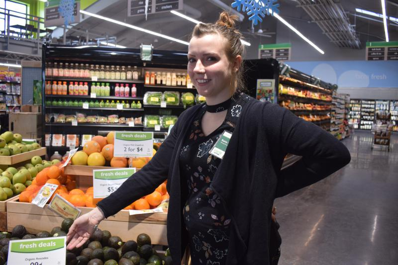 Rainie Themer, marketing manager for Green Top Grocery, says the store has lowered prices on produce and several staples to attract more customers from the west-side neighborhoods. Sales are designated by green or purple signs.
