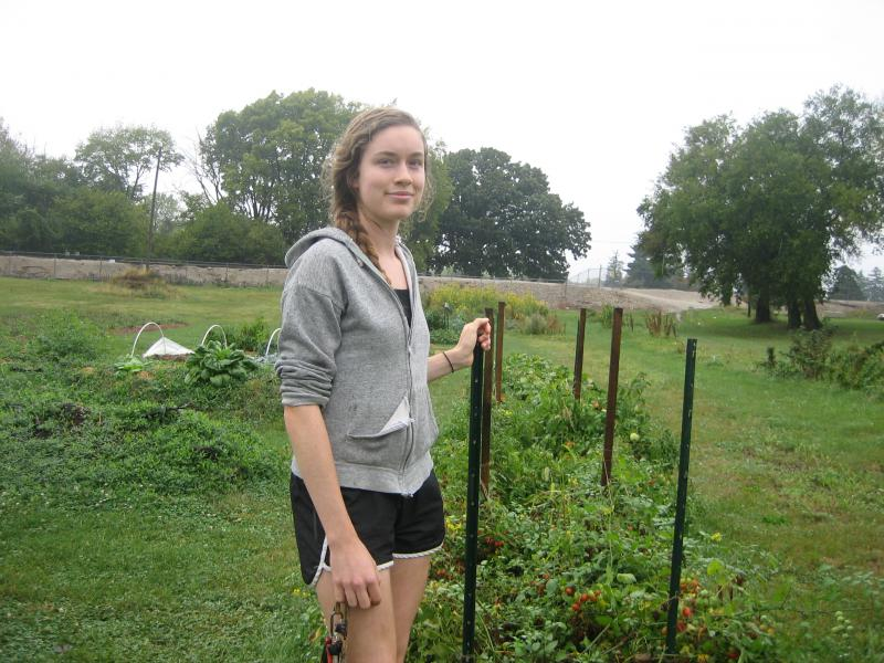 Colleen Connolly, an Illinois State University student, helped start the West Bloomington Active Community Garden with her mother Jan. The garden allows west side residents to plant their own vegetables.