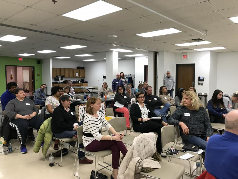 Health care providers and residents gather at the Normal Public Library for a town hall meeting on HIV prevention. The McLean County Health Department partnered with Illinois Getting to Zero, a group based in Chicago.