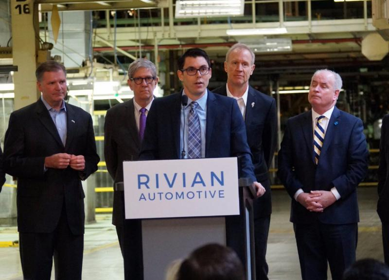 Rivian Founder and CEO R.J. Scaringe speaks at the Normal plant in March 2017 during a visit from Gov. Bruce Rauner and other elected officials.