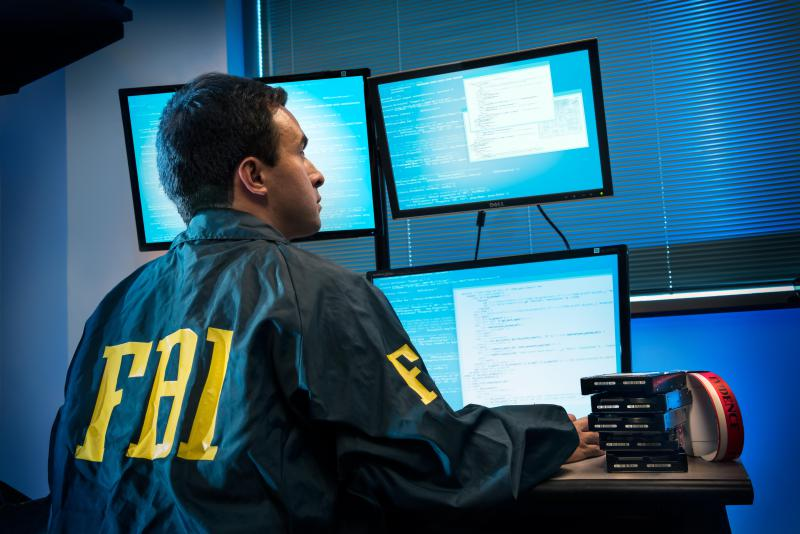 Cyber agent investigates electronic intrusion