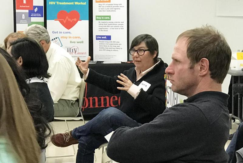 Attendees gather at the Normal Public Library on Thursday for a town hall meeting on HIV prevention. One woman shares her perspectives.