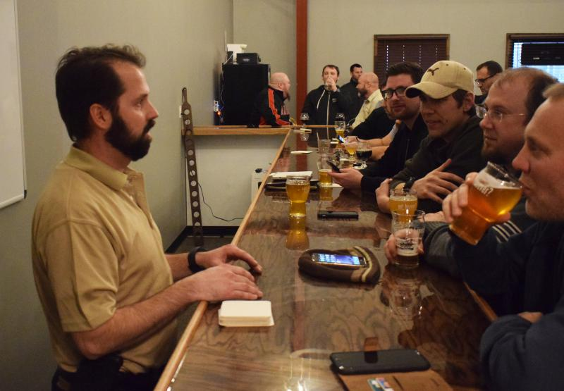 Chad Bevers talks with patrons at the Lil Beaver Brewery taproom.