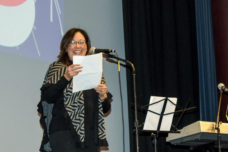 Illinois State Professor Yojanna Cuenca-Carlino spoke during the benefit concert