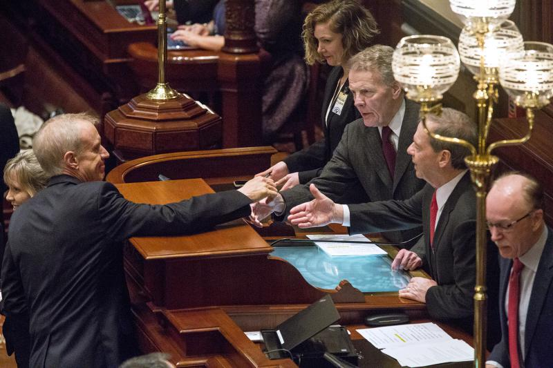 Gov. Bruce Rauner shakes hands with Democrats Mike Madigan and John Cullerton during his budget address in Springfield on Wednesday, Feb. 14, 2018.