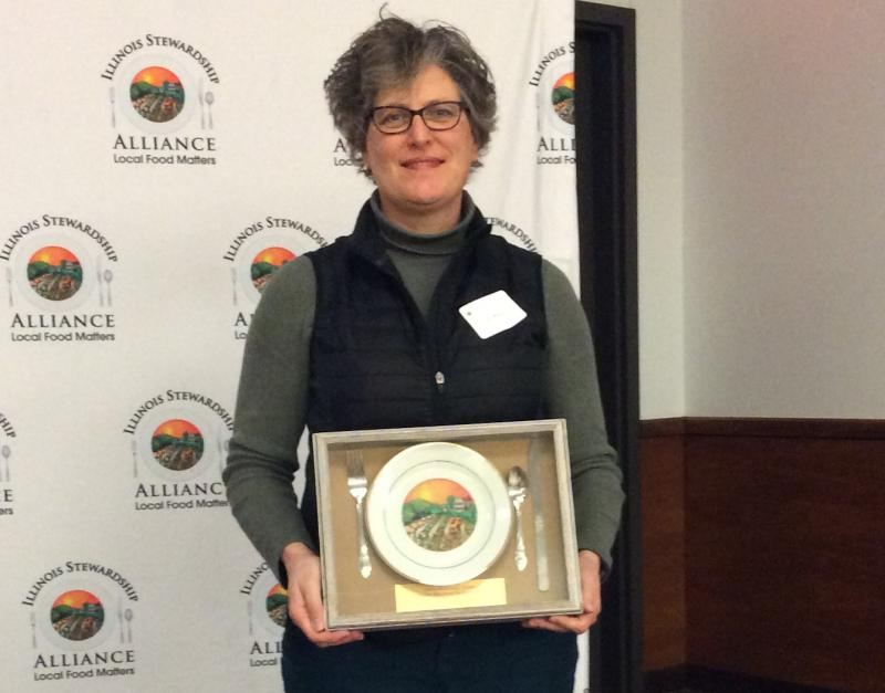 Spence Farm Foundation Executive Director Erin Meyers accepts Golden Beet award for its Bread Camp.