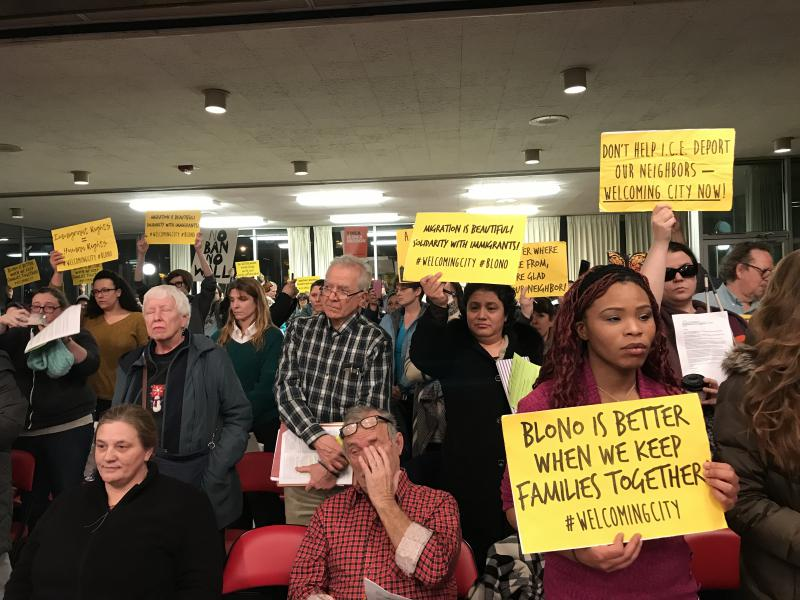 Supporters of the Welcoming City ordinance gather at Monday's Bloomington City Council meeting to urge council to reconsider discussion of the measure.