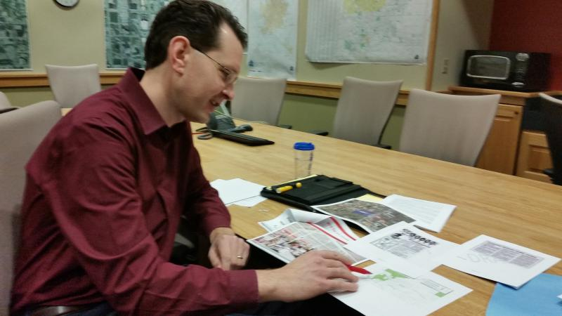 Austin Grammer, Bloomington's economic development coordinator, looks over a U.S. Department of Agriculture map showing food desersts in the Twin Cities.