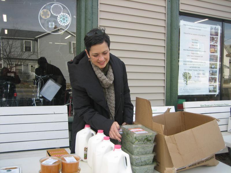 Deborah Halperin, a board member of the West Bloomington Revitalization Project, sorts food donations from Green Top Grocery outside WBRP office on West Washington Street.