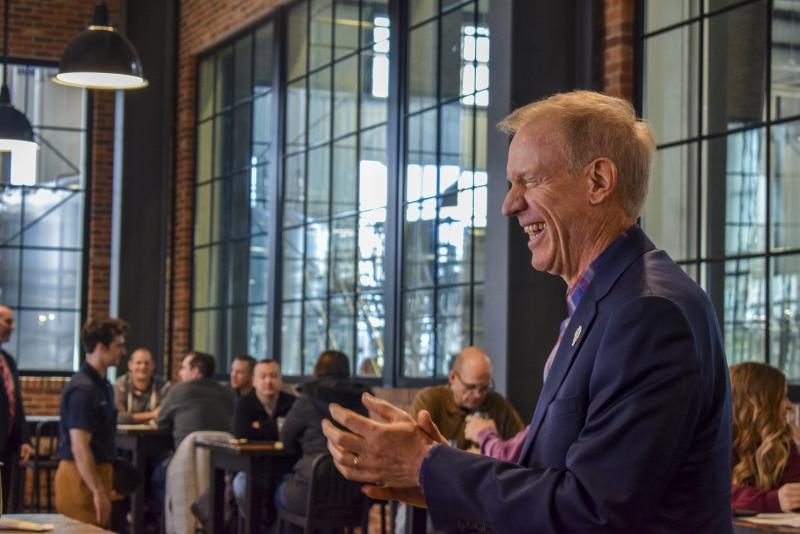 Rauner greets patrons at Destihl's beer hall before taking a tour of the brewery.