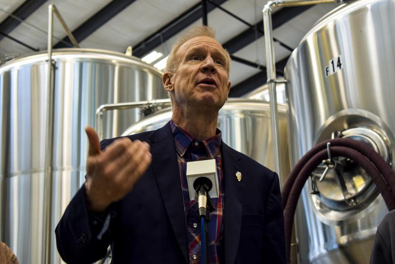Gov. Bruce Rauner speaks Saturday, Feb. 3, 2018, during a visit to the new Destihl brewery in Normal.