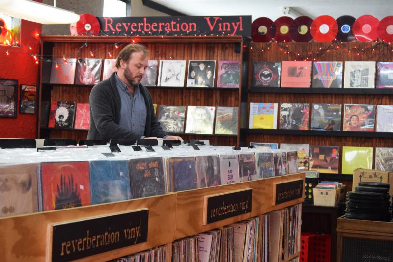 John Anderson inside his Reverberation Vinyl store in Bloomington, near Illinois Wesleyan University.