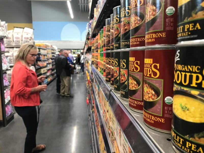 Green Top Grocery owners look at their new store during a sneak peek event Tuesday, May 2, 2017.