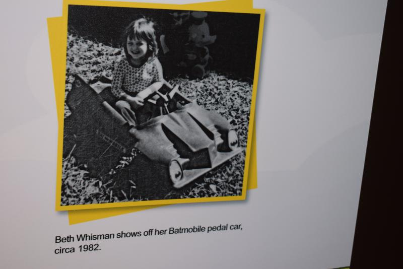 Former museum director Beth Whisman as a toddler on a Batmobile Pedal Car.