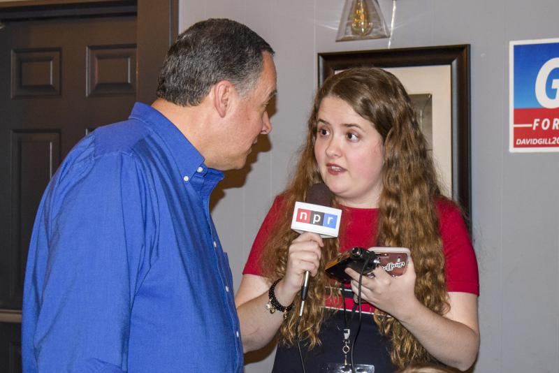 Democrat David Gill speaks with GLT's Baylee Steelman at his campaign watch party Tuesday, March 20, 2018, at Lucca Grill in downtown Bloomington.