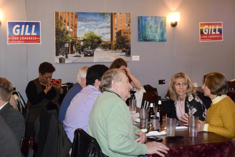 David Gill supporters at his campaign watch party Tuesday, March 20, 2018, at Lucca Grill in downtown Bloomington.