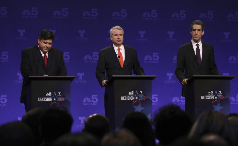 Democrats running for Illinois governor, from left, billionaire J.B. Pritzker, businessman Chris Kennedy, and state Sen. Daniel Biss take their podium positions before a televised forum Tuesday, Jan. 23, 2018, in Chicago.