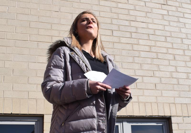 Faithe Wenger, a senior at Normal Community High School, speaks during the walkout demonstration Wednesday, March 14, 2018.