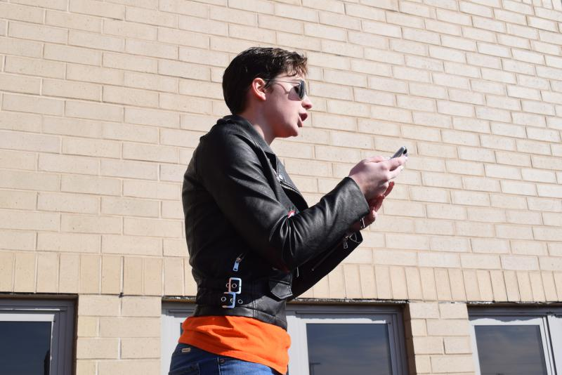 Junior Tristan Bixby speaks during the walkout demonstration Wednesday, March 14, 2018.