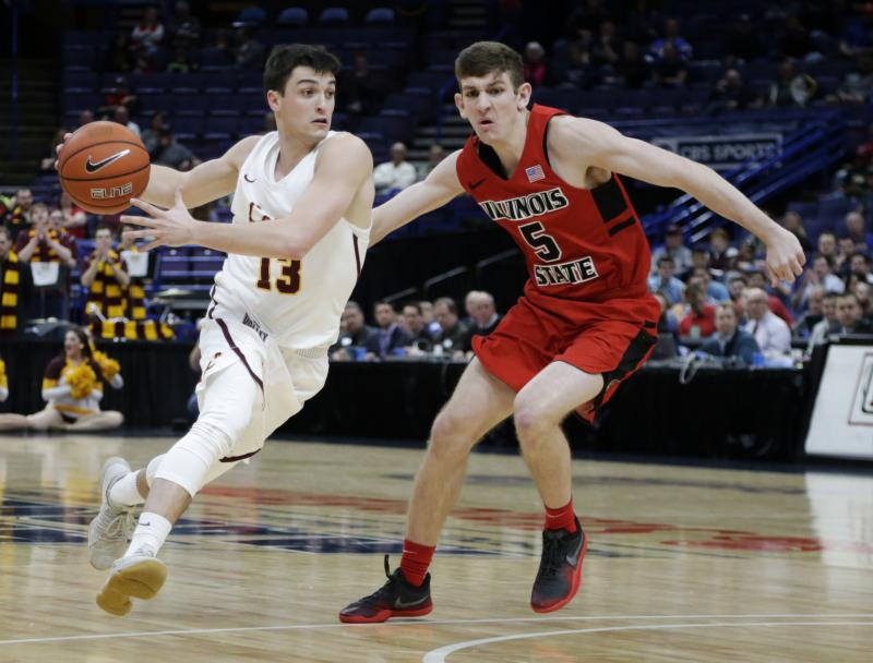 Loyola's Clayton Custer (13) drives the ball around Illinois State's Matt Hein (5) during the first half in the championship of the Missouri Valley Conference tournament March 4, 2018, in St. Louis.