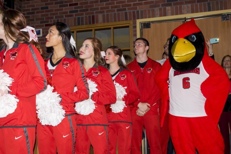 Reggie Redbird and ISU cheerleaders cheer with fans.