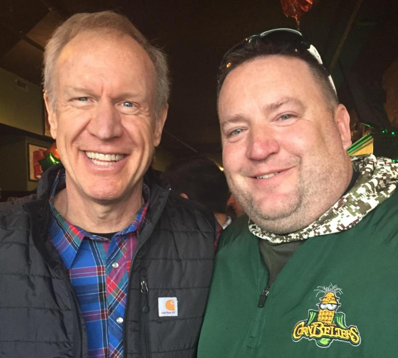 Gov. Bruce Rauner with St. Patrick's Day revelers Saturday, March 17, 2018, at Maggie Miley's in Normal.