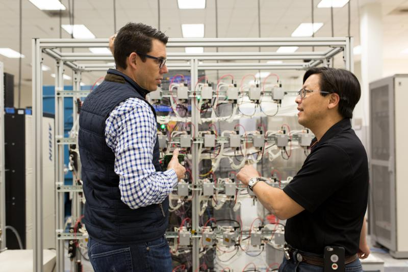 Rivian CEO RJ Scaringe (left) and battery engineer Charles Chang at the company's facility in Irvine, CA.