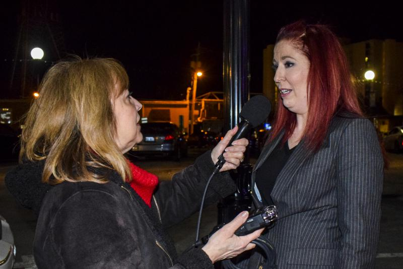 McLean County Board candidate Shayna Watchinski speaks with GLT's Judith Valente at her campaign watch party Tuesday, March 20, 2018, in downtown Bloomington.