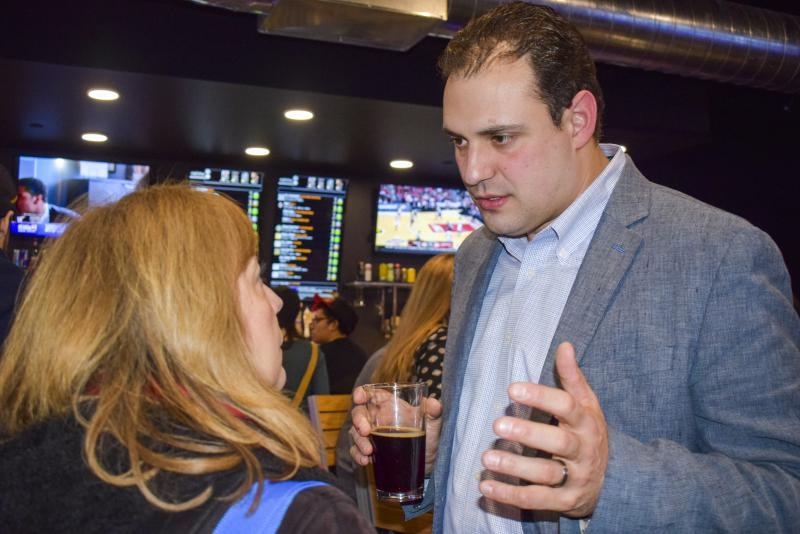 McLean County Board member Carlo Robustelli speaks with GLT's Judith Valente at Shayna Watchinski's watch party Tuesday, March 20, 2018, in downtown Bloomington.