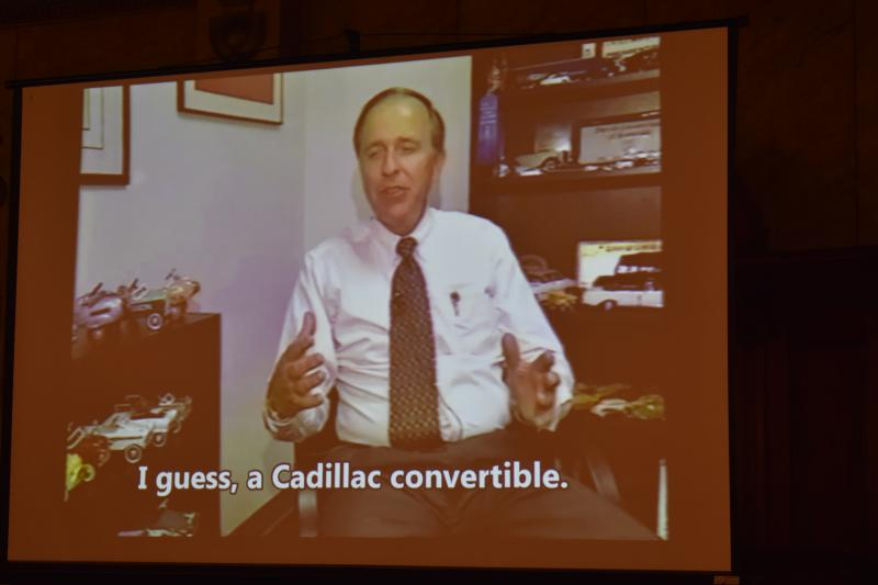 A photo of Bruce Callis from a video screen.