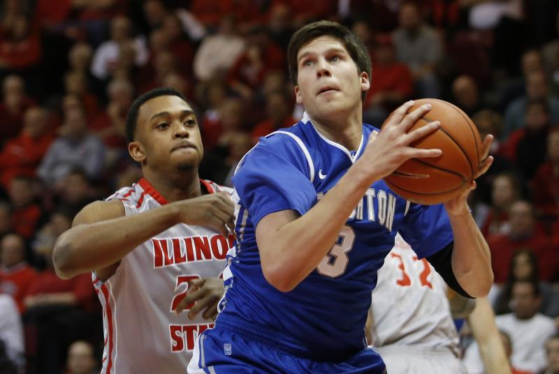 In this Jan. 2, 2013, file photo, Creighton's Doug McDermott (3) looks for room to shoot past Illinois State's Zeke Upshaw (24) during the first half of an NCAA college basketball game at Redbird Arena in Normal.