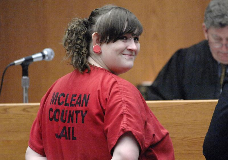 Brittney Mikesell smiles at her mother, Melody Justus, while making an appearance in McLean County court Thursday, April 5, 2018. Mikesell faces murder charges in the death of her boyfriend, Cullen Hedrick.