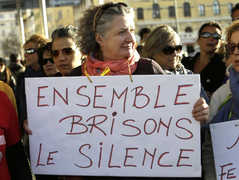 "The # Me Too movement has sparked a global fight against sexual harassment. At a protest in Marseille, France last fall, this woman held a sign that said ""Together Let Us Break the Silence."" Harassement will be a topic at a Tuesday employment law summit."
