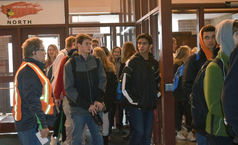 U-High students walk into Redbird Arena to gather on the east balcony before reuniting with their parents and guardians.