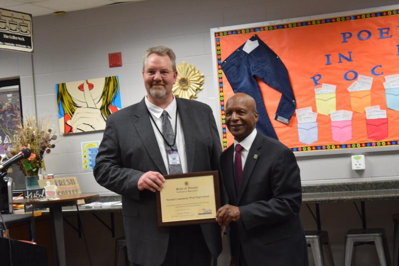 Illinois Secretary of State Jesse White presenting Normal West Principal Dave Johnson with a certificate for dedication to organ donation.