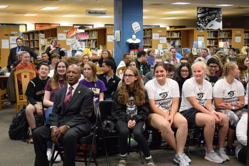 Illinois Secretary of State Jesse White sits with Normal West students.
