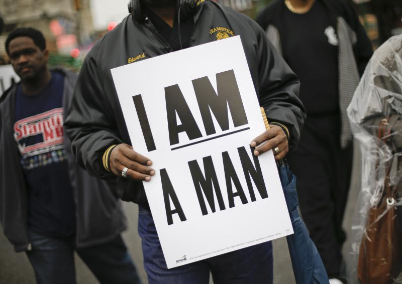 On the 2013 anniversary of Dr. King's death, a protester displays a sign similar to the ones carried during the 1968 sanitation workers' strike in Memphis.