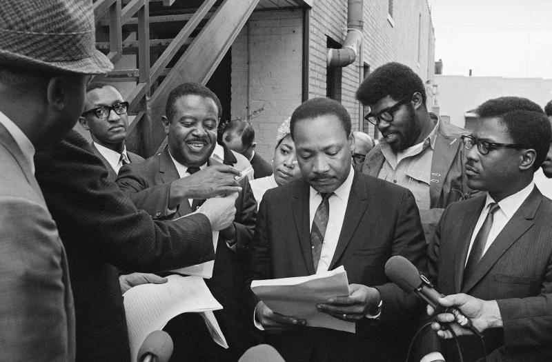 Dr. King in Memphis, the day before he died. He is looking at a restraining order filed against him, prohibiting him from leading a march in the city.
