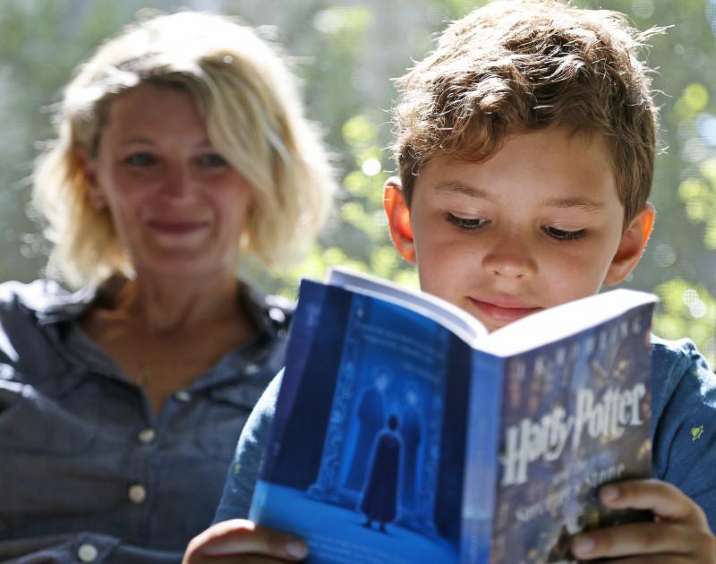 Child reading Harry Potter.